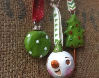 Set of Three Christmas Folk Art Ornaments One snowman polka ball and christmas tree in white red and green