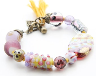 Purple Lampwork Glass Beaded Bracelet on Marigold Yellow Cord with Tassel (B65A)