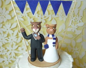 mascot cake topper with banner and birch base