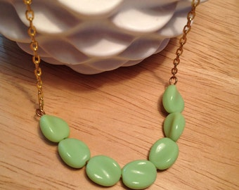 Vintage green beaded necklace on a gold plated chain