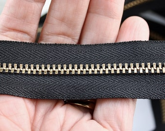 Brass zipper .... 3 yards  of black