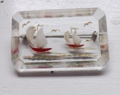 Vintage 1940s reverse carved lucite brooch or pin nautical sailboat seagull scene