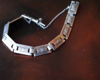 Antique 1920 solid silver 800  art deco style panel bracelet with a safety chain.Size 7