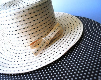 Glamour vintage 70s beige straw hat with a tall crown, black decorative stitches, tie-bow on the back. Made by Sears Millinery . Size 21 1/2
