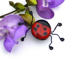 Fused glass bug in red with black dots, lady bug