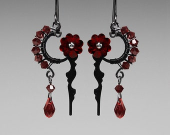 Thanatos II v10: Dark and elegant wire wrapped steampunk earrings with vintage clock hands and red Swarovski crystals