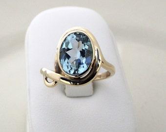 9k yellow gold ring with blue topaz. Light blue topaz ring. 9k ring. Large gemstone ring.