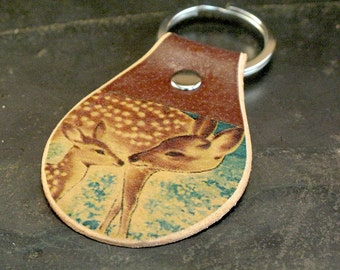 Deer keychain on leather