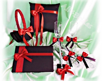 Red and black wedding set, ring pillow, basket, guest book, pen set, cake set and champagne glasses.