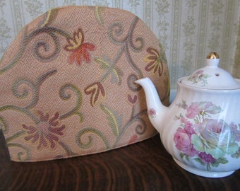Flowered Upholstery Fabric Tea Cozy on Orange