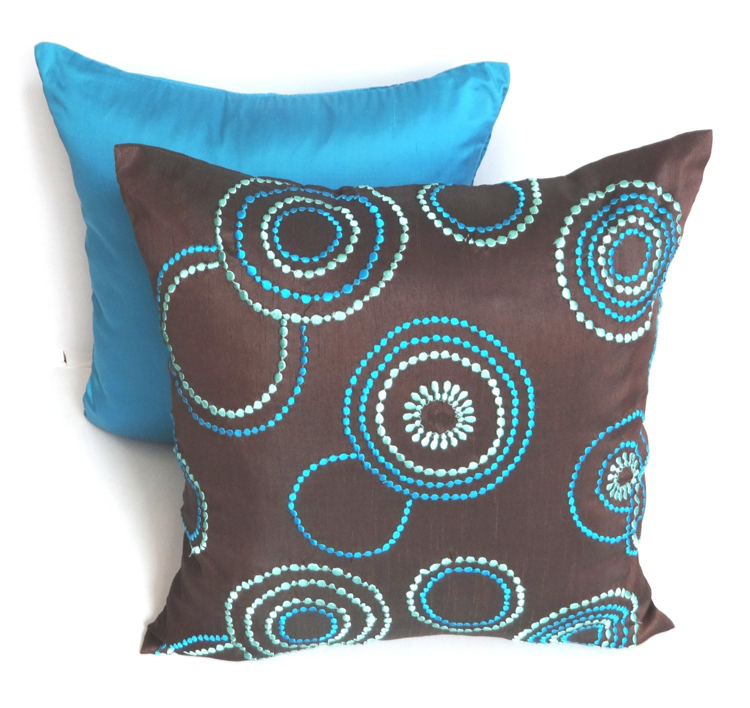 Brown throw pillow embroidered w/ teal blue and aqua blue