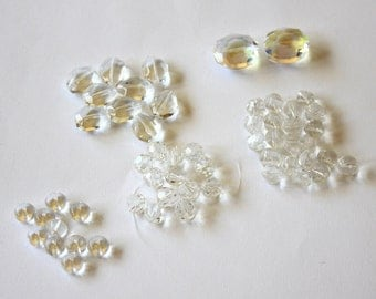 Chinese Crystal clear glass assortment(55 beads) of faceted rounds, helix rondelles, and oval beads DESTASHING