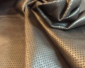 An dark chocolate brown lambskin leather - thin and soft with full of small holes pattern (perforated) - a 5 square foot hide