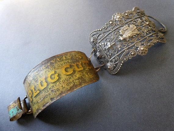 Mutalibun. Rustic assemblage cuff bracelet of filigree and salvaged tin.