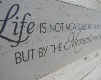 Life is not measured by the breaths we take - large wood sign