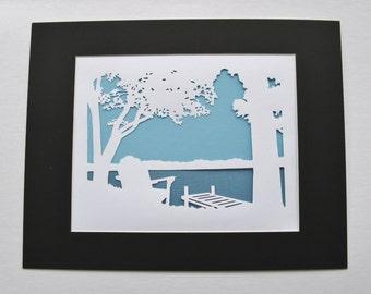 Adirondack Chair Dock Lake Trees Silhouette Wall Art Paper Cut Art 14x11 white blue black mat
