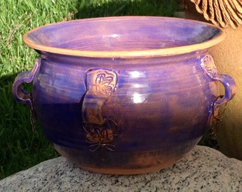 "Ceramic bowl, Blue/ purpule glaze w five handles and wire "" earings"". Food safe."