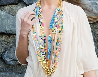 Designer statement necklace - Sea Candy - Handmade long woven seed bead Aztec print necklace with chunky gold chain. Neon pink & orange.
