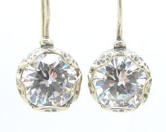 Flower shaped white zircon earrings in sterling silver