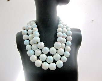 Three strand hand painted  large wood bead necklace.  Pale blues and cream whites.  Toggle closing. Hand painted. Soft colors.