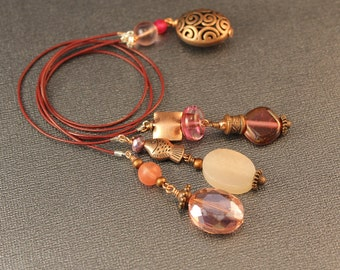 La Rossa Pinks, Magentas, and Copper Bookmark - Three Strand Leather Cord Book Mark with Glass, Crystal, Rose Quartz and Copper Beads