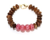 Wooden and pink lamp work glass beaded tribal bracelet