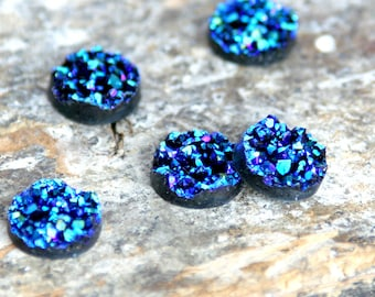 """Faux druzy resin cabochon in peacock colors - sparkling iridescent blues, greens, and gold. 1/2"""" (12mm) pack of 10. For earrings / rings."""