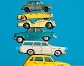 Photograph of a stacked vintage toy cars, shot against a bright blue background - Wall art, kid room, nursery art, colorful, VW, Volvo, MG