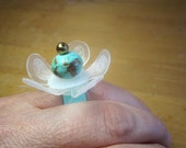 Upcycled adjustable bronze and teal flower ring