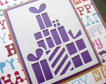 stack of presents on happy background - handmade greeting card