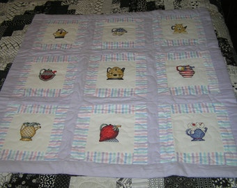 Handmade Baby quilt with needlepoint teapots