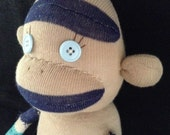 Tan and Blue Argyle Sock Monkey with blue button eyes