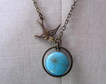 Round Flat Turquoise stone in round chain filigree with antique bird connected in antique chain long necklace assymetric