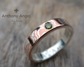 Ladies Mokume Gane band.  ( MK-SOLID ) 4mm Wide Set with a 2.6mm Green Diamond