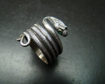 Unique Sterling Silver and 14k gold Snake ring with genuine pave diamonds and emerald eyes.