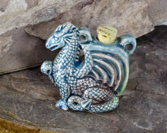 Peruvian Ceramic Raku Dragon Bottle