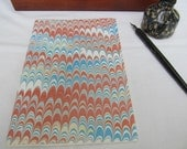 Terra cotta, blue and cream hand marbled paper hand sewn notebook
