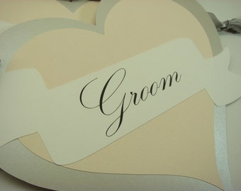 Wedding Chair Signs in a Heart Shape with wording Bride and Groom