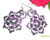 Handmade tatted earrings made of violet cotton thread and black beads