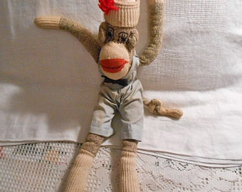 Lovable SOCK MONKEY DOLL Blue Romper Outfit, Black Bow Tie, Watch Cap Red Pompom, Stitched Eyes, Long Arms & Legs, 1940s Too Cute Handmade