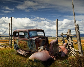 Abandoned Rusty Auto Sedan Wreck in a Grassy Field by a decrepit Corral Fence out West No.6672 A Fine Art Auto Landscape Photo
