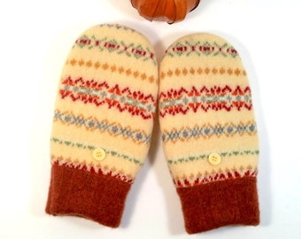 Warm, wool mittens for petites or younger teens. Yellow and rust colors. Scandinavian knit design. Fleece lining.