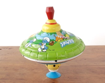 Vintage Smurfs spinning top by the Ohio Art Company, tin litho metal toy, lime green, yellow, red, blue, 1980s cartoons, 1982