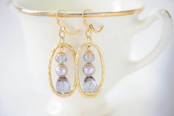https://www.etsy.com/listing/230635509/purple-gold-dangle-earrings-pastel?ref=shop_home_active_22
