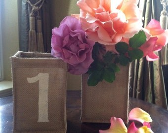 Bulap covered glass vase, table numbers