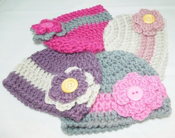 Baby girl hats with double flower.  Choice of 4 colors in newborn -3 months,3-6 months, 6-12 months.  Great baby gift.