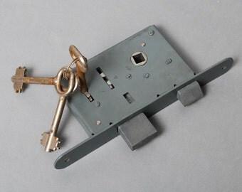 Vintage metal door lock with three original keys