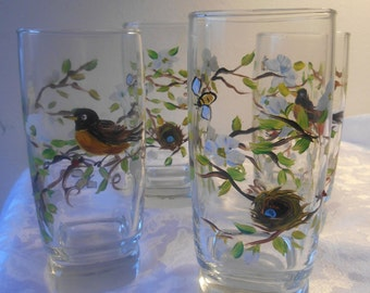 4 large drinking glasses, robin and nest.