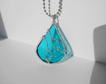 Teal green stained glass teardrop pendant with wire design