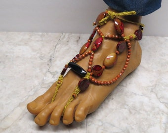 Pair of Red, black, yellow, and tan bottom-less sandals in adjustable adult size. Barefoot fashion and bellydancers. HFT-674